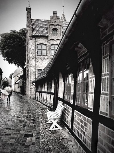 white bench under rain Denmark Bnw_friday_eyeemchallenge Bnw_benches Rainy Day Architecture Built Structure Building Exterior Building City