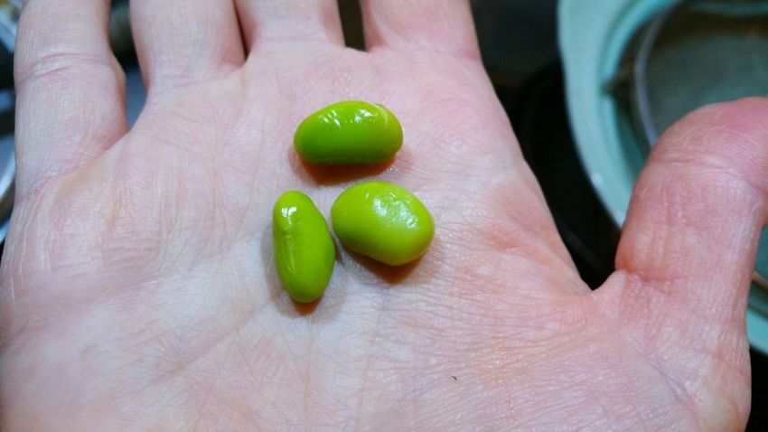Three Green Beans on a Palm Of The Hand Human Hand Human Body Part Green Color Close-up Holding One Person People Palm Adults Only Only Women Indoors  Adult Food Edamame Soybeans Soy Soya Cooking Kitchen Nutrition Legume Bean