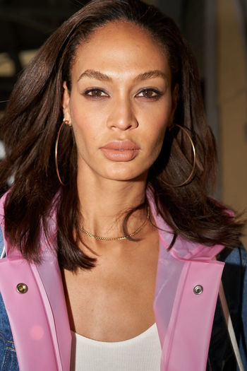Joan Smalls after Cavalli fashion Show in Milan. Milano Fashion Week, February 2018 2018 Cavalli Fashion Joan Smalls Pink Day Mfw Milan Fashion Week Model One Person Pink Color Raincoat Real People Style Young Adult Young Women