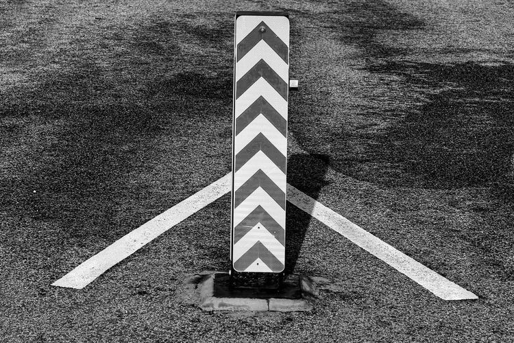 Chevrons Parking Lot Arrow Sign Asphalt Chevrons Close-up Day High Angle View No People Outdoors Road Transportation Warning Sign