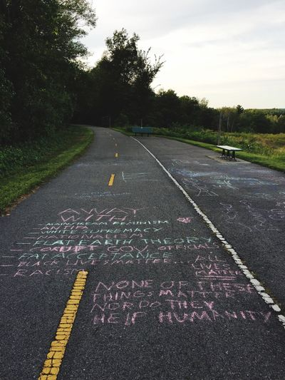 Road Asphalt Outdoors Communication Graffiti Politics The Week On EyeEm Handwriting  Communication