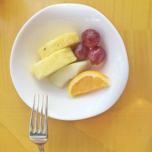 High angle view of fruit salad served in bowl on table