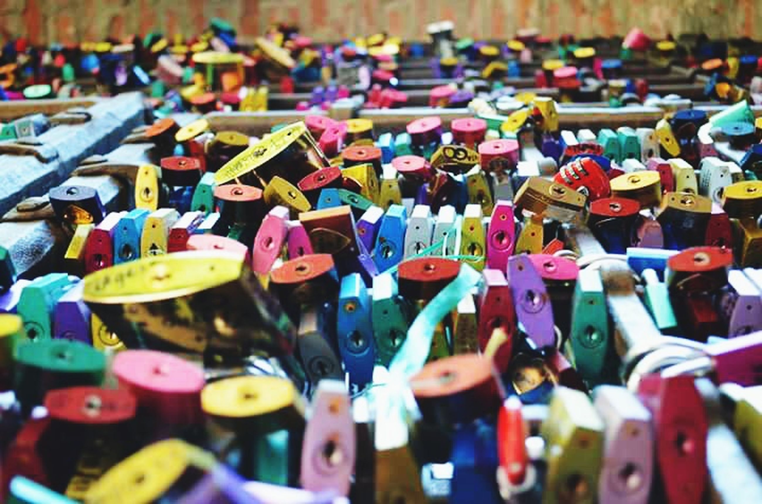 large group of objects, abundance, multi colored, selective focus, variation, in a row, focus on foreground, close-up, padlock, choice, full frame, order, colorful, repetition, backgrounds, metal, arrangement, day, lock, high angle view