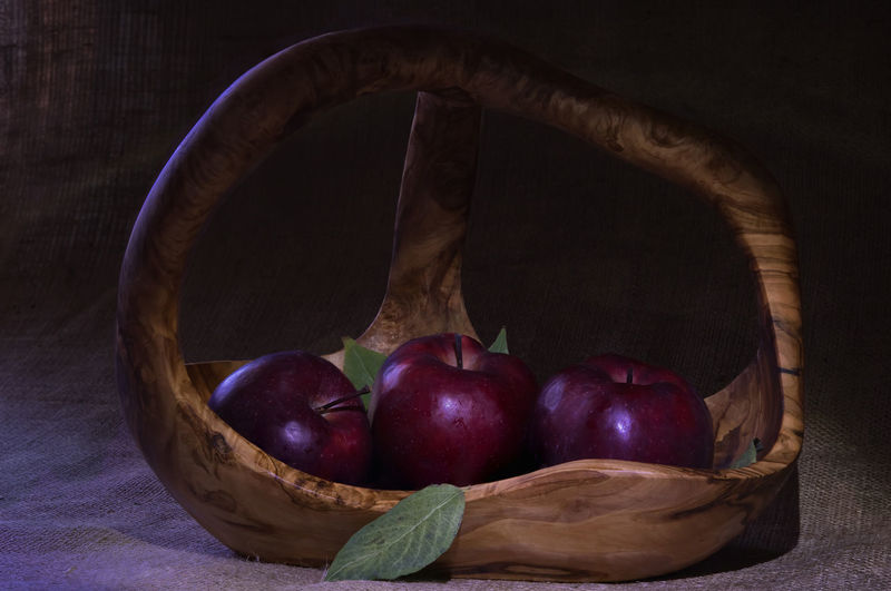 EyeEmNewHere Natural Red Shiny Apples Apples In Basket Apples With Leaves Basket Close-up Colorful Creative Food Food And Drink Fruit Healthy Eating Healthy Food Indoors  Leaves Organic Organic Food Red Apples Red Fruits Still Life Three Apples Wooden Basket
