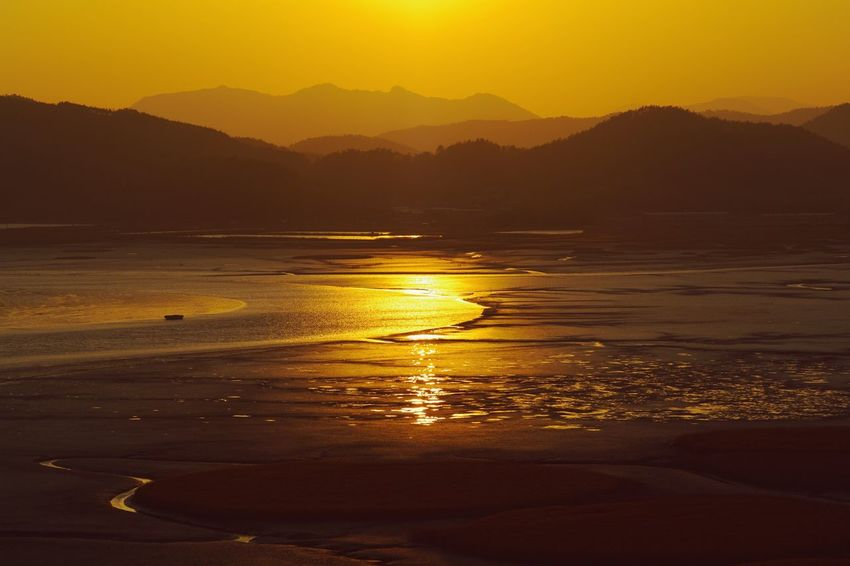 Golden flow Golden Light Sunset Sky Water Beauty In Nature Scenics - Nature Mountain Tranquil Scene