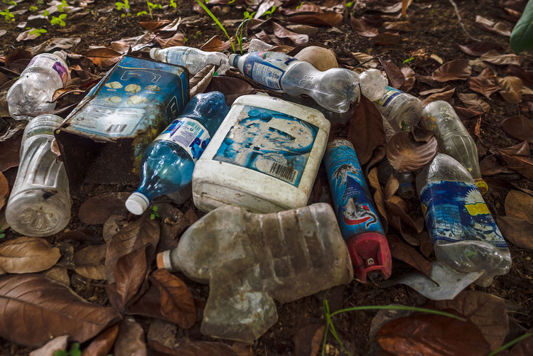 Plastic waste, aerosol and environment Abandoned Abundance Aerosol Can Bottle Close-up Container Damaged Dirt Environment Environmental Issues Garbage Heap High Angle View Land Large Group Of Objects No People Obsolete Outdoors Pollution