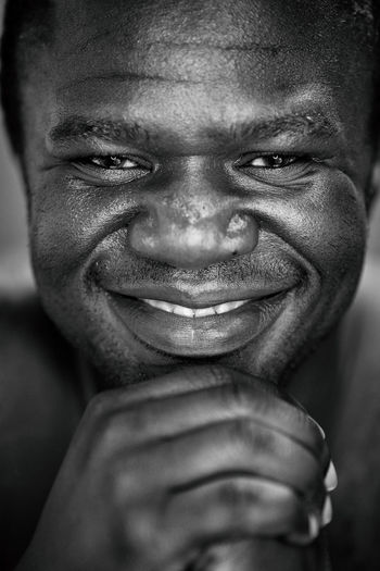 African Portraits Black Black And White Close-up Front View Human Face Human Hand Looking At Camera Male Men Monochrome _ Collection monochrome photography One Person Portrait Positive Emotion Skin Skin Color Smile Smiling
