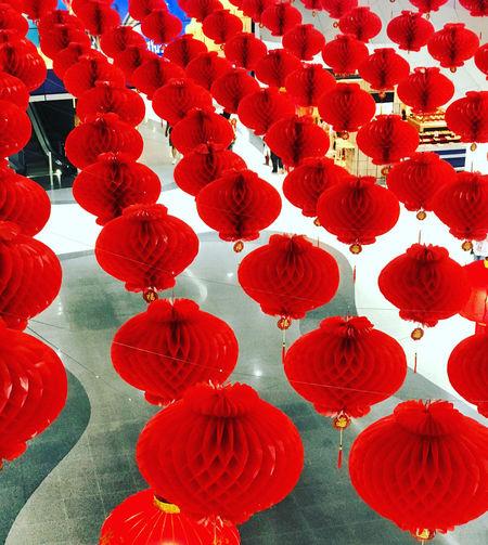 Red lanterns hanging on wall