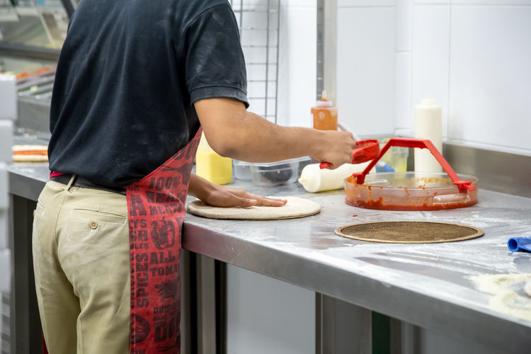 Dough Table Hands Men Pizza Making Flour Food Kitchen Baker Chef Cooking Pastry Kneading Bakery Preparation  person Adult Hand Meal Preparing Cuisine Baking People Board Cook  Raw Working Counter Mixing Male Fresh Commercial Work Restaurant Prepare