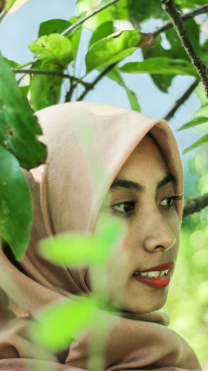 Close-up of young woman in hijab looking away