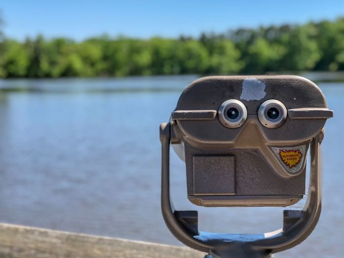 Sightseeing in nature Focus On Foreground Water Day Close-up No People Coin Operated Nature Binoculars Sunlight Outdoors Coin-operated Binoculars Metal Security Lake Sky Land Beauty In Nature Beach Personal Accessory