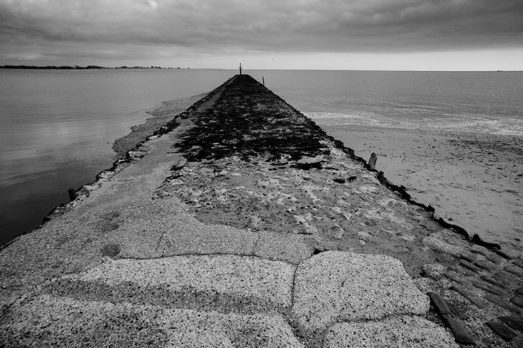 Leading Skywards Pier Beach Beauty In Nature Blackandwhite Built Structure Cloud - Sky Day Diminishing Perspective Horizon Horizon Over Water Land Nature No People Sea Sky Solid The Way Forward Tranquil Scene Tranquility Water