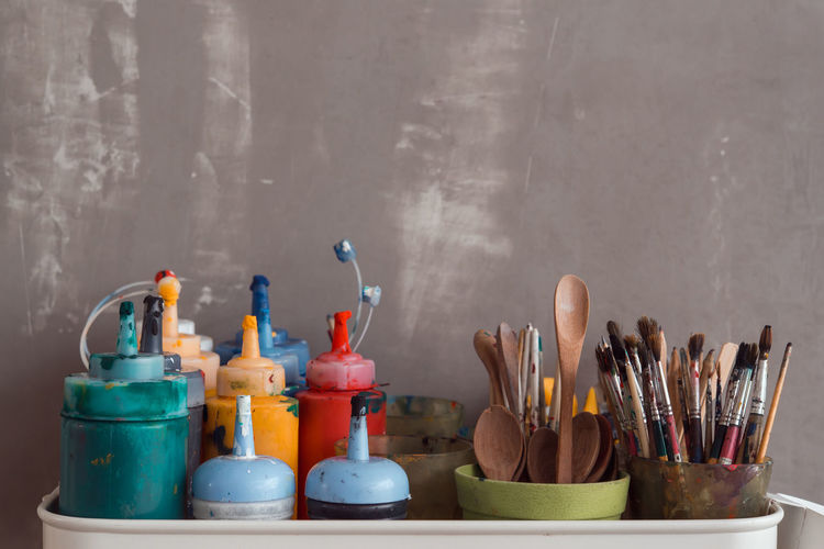 Close-up of color and paintbrush against wall