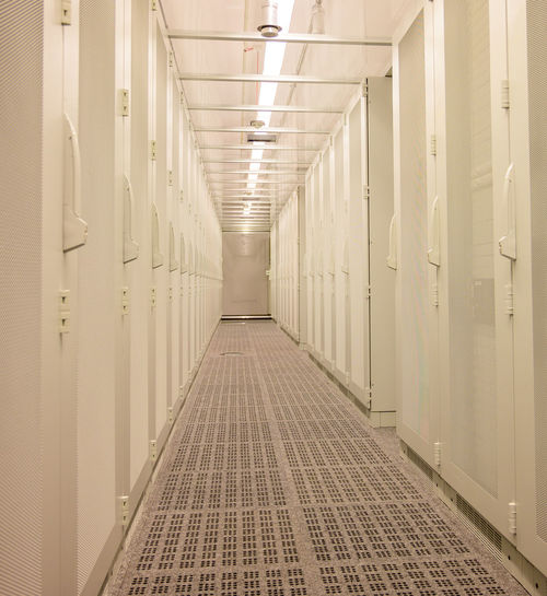 Cold aisle and front view of server racks in a data center
