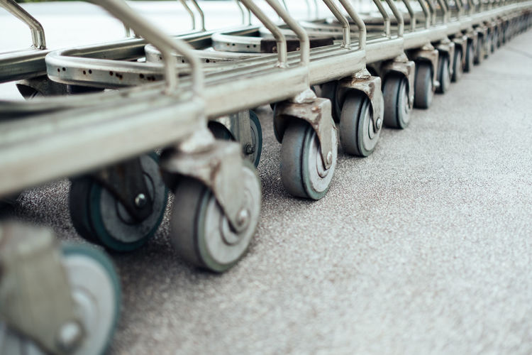 Arrangement Car City Close-up Consumerism Day High Angle View In A Row Land Vehicle Large Group Of Objects Mode Of Transportation Motor Vehicle No People Road Selective Focus Shopping Cart Side By Side Silver Colored Street Surface Level Tire Transportation Wheel