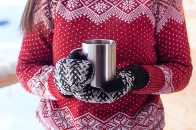 Young woman in red sweater with hot drink in winter Mug Snowy Mittens Warming Morning In The Mountains Morning Sweaterweather Sweater Hot Drink Cozy Hot Tea Steam Midsection Women Drink Winter Cup Holding Refreshment Warm Clothing Mug Red Clothing Lifestyles Front View Drinking Coffee