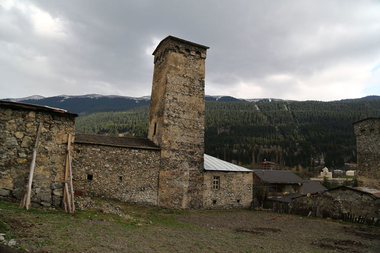 Architecture Built Structure Sky Cloud - Sky Building Exterior Nature History Mountain The Past Building No People Old Plant Land Ancient Landscape Environment Day Outdoors Field Ancient Civilization Georgia Mestia/town In Svaneti/Georgia