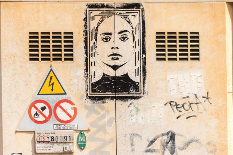 Beautiful street art in Italy Architecture Art And Craft Building Building Exterior Built Structure Close-up Communication Creativity Day Graffiti Human Representation Male Likeness Mural No People Outdoors Representation Sign Streetart Text Wall - Building Feature Warning Sign Yellow