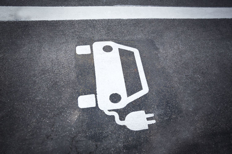 Parking symbol for electric cars being charged Alternative Asphalt Automobile Battery Car Charge Charging Charging Station Charging Zone City Concept E Ecology Electric Europe Future Green Hybrid Infrastructure Lot Mobility Modern Outdoors Parking Plug Point Power Renewable Sign Slot Station Street Symbol Technology Traffic Transport Transportation Urban Urbanity Vehicle White Zone Guidance Road Marking Marking Ecar E-car Parking Lot Electric Car Climate Change