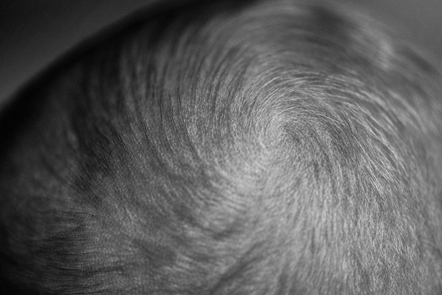 Minimalism Abstract Shapes And Patterns  Spiral Hair Close-up Indoors  Full Frame Backgrounds One Person Human Skin Real People Skin Textured  Pattern Circle Extreme Close-up Body Part Directly Above Human Hair Detail Unrecognizable Person