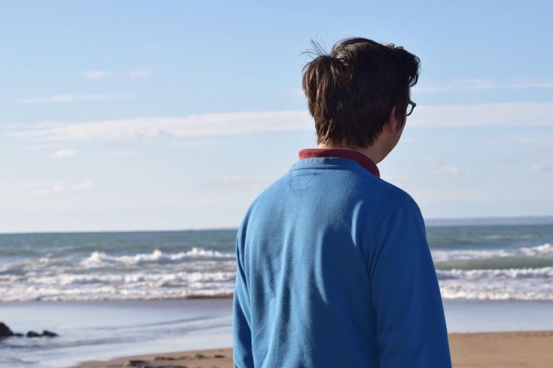 EyeEm Selects Rear View Horizon Over Water Beach One Person Real People Scenics Standing Outdoors Day Lifestyles Beauty In Nature Water Be. Ready. Man Standing Looking Out To Sea Waiting And Thinking Of His New Baby Arrival Due Soon Portrait
