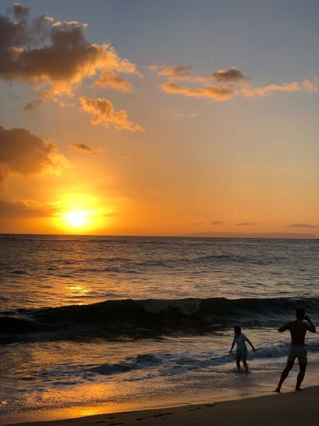 Hawaii Kauai Sea Shore Beach Sunlight Sunbeam Sunset Taking Pictures Young Woman Man People Sunset Sea Beach Horizon Over Water Beauty In Nature Scenics Orange Color Nature Water Leisure Activity Togetherness Lifestyles Vacations Sand Silhouette Cloud - Sky Real People Walking