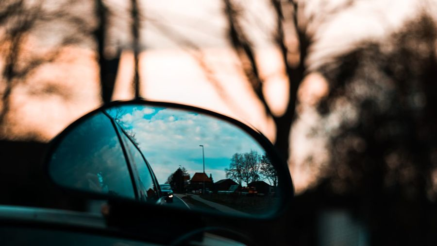EyeEm Best Shots EyeEm Selects EyeEm Gallery Reflection Car Tree Motor Vehicle Nature Glass - Material Built Structure Mode Of Transportation Architecture Transportation Close-up Focus On Foreground Land Vehicle Building Exterior Mirror No People Outdoors Sky Day