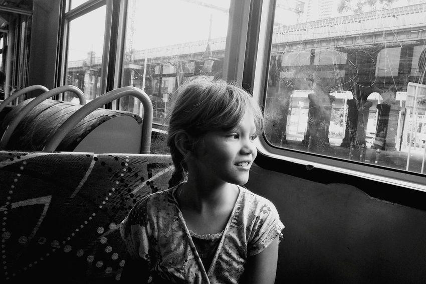 Little kid amazed by the big city. Amazing B&W Portrait Pleasure City Life Happiness Happy Smiling Kidsphotography Kid Beautiful Melbourne Train Train Station Window View Blackandwhite Gorgeous