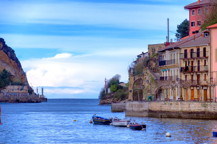 Waterfront view of the town Donibane with boats in Spain Water Nautical Vessel Waterfront Architecture Building Travel Outdoors SPAIN Donibane Pasai Donibane - Euskalherria Town Pasajes Mountain San Pedro River Ulia Jaizquibel Boat Sansebastian Village Medieval Basque Country Landscape Euskadi Bay