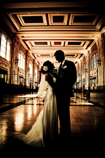 Adult Architecture Bonding Bride Bridegroom Couple - Relationship Day Full Length Groom Indoors  Lifestyles Love Men People Real People Standing Togetherness Two People Wedding Dress Women Young Adult Young Women