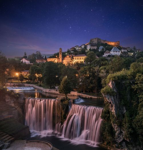 Scenic view of waterfall at night