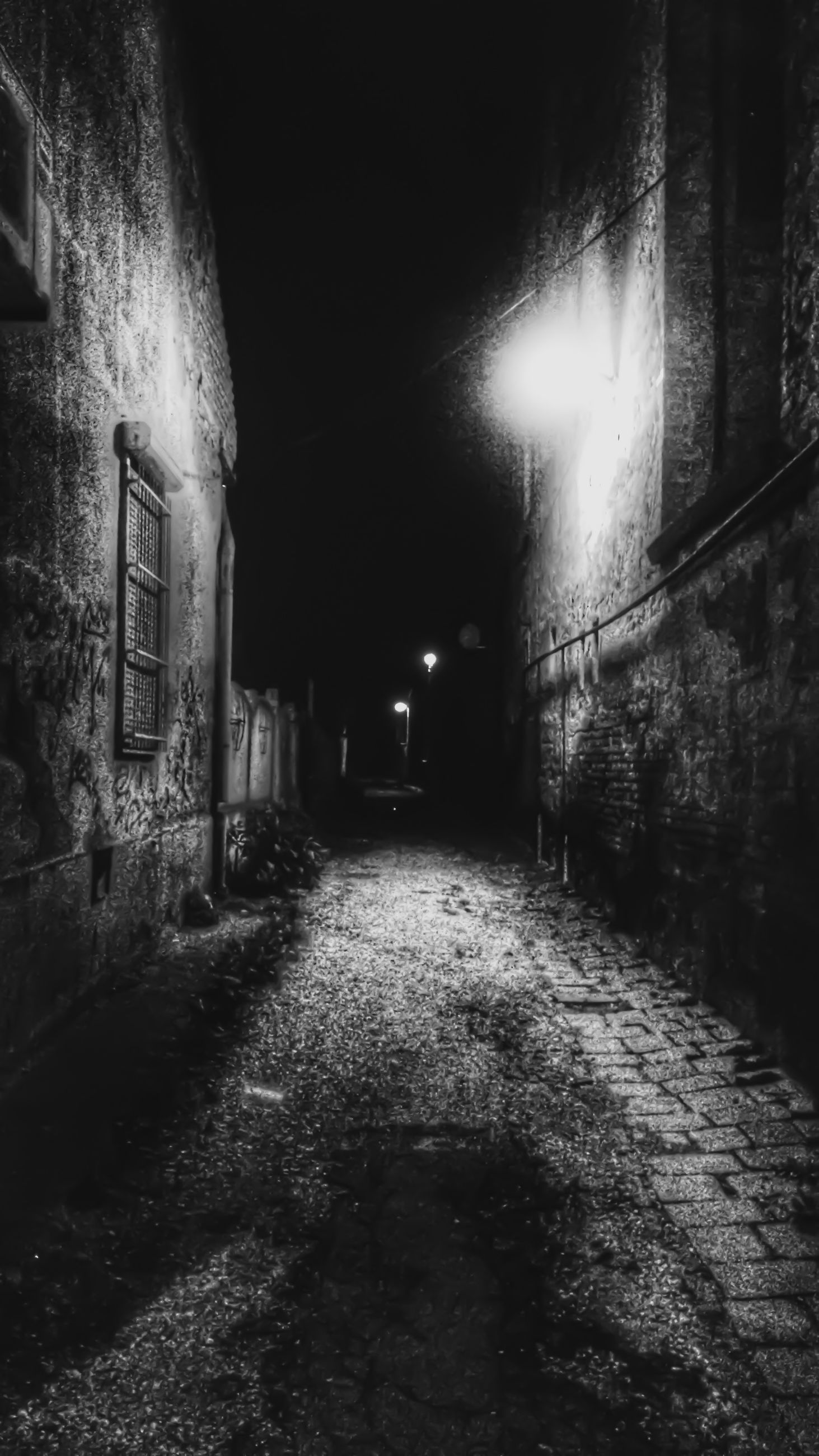 illuminated, the way forward, architecture, night, built structure, building exterior, lighting equipment, diminishing perspective, street, street light, alley, building, narrow, vanishing point, cobblestone, empty, city, light - natural phenomenon, wall - building feature, residential structure