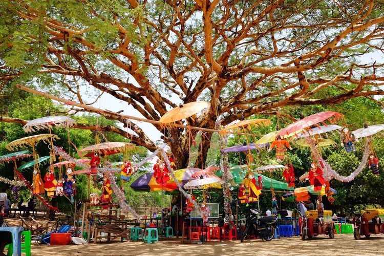Souvenirs in the wind Myanmar Bagan Tree Multi Colored Sky Colorful Stall Display For Sale Shop Market Stall Window Display