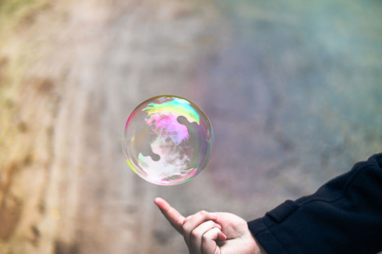 The soap bubble world Adult Beautiful Bubble Bubble Wand Calm Close-up Elegant EyeEm Best Shots EyeEm Gallery Finger Fragility Holding Human Hand Instagood Instagram Leisure Activity Nature One Person Outdoors Photography Real People Soap Bubbles EyeEmNewHere This Is Masculinity