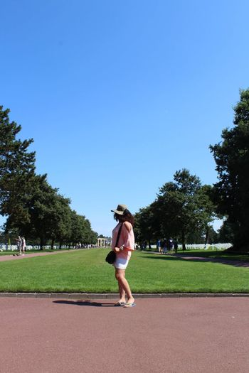 Full length of woman against clear blue sky