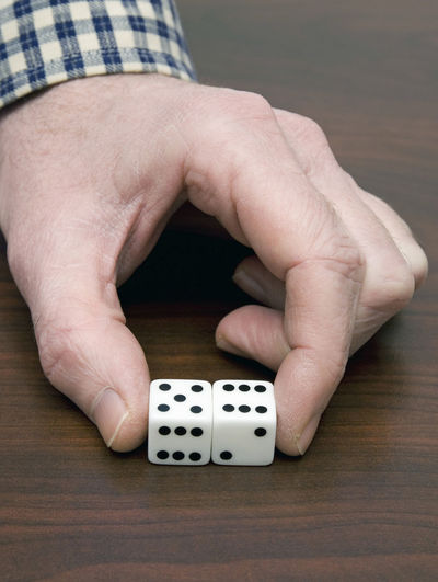 fingers holding dice Luck Lucky Addiction Bet Chance Close-up Dice Fingers Gambling Game Holding Human Finger Human Hand Indoors  Leisure Activity One Person People Playing Real People Table