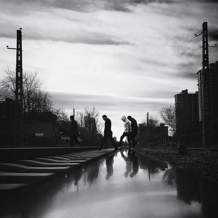 Silhouette Cloud - Sky Adult Sky Outdoors Day Street Photography City Life Shadows & Lights Cityscape Beijing, China Shadow Light And Shadow Huawei P9 Photos Silhouette Black And White Low Angle View Railway Track Mirrored Reflection The Way Forward Tranquil Scene City Street Walking Railroad Track