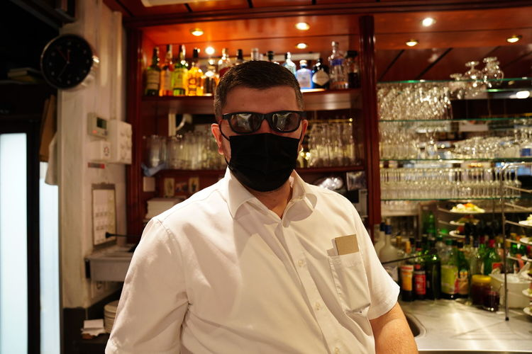 Portrait of man standing in restaurant