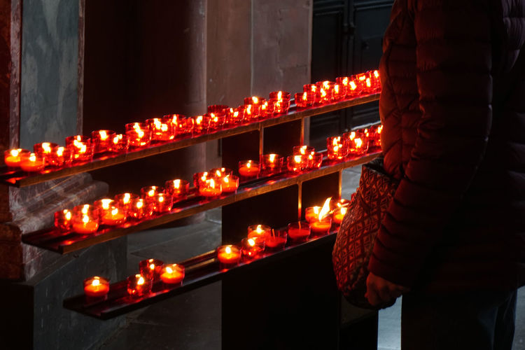 prayer candles Candles Church In A Row Red Burning Candle Flame Illuminated Lighting Lit Many Prayer Prayer Candles Religion Row Unrecognizable Person