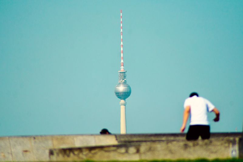 Rear view of man by fernsehturm