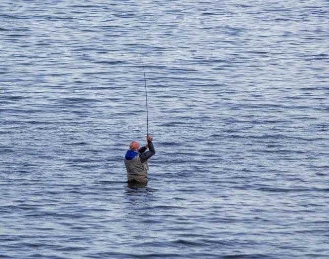 Man fishing in sea