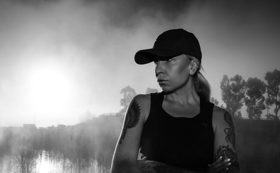 One Woman Only Cloud - Sky Portrait Sky Nature Fog Nature Androgyny Androgynous Tiina Blackandwhite Photography Blackandwhite Sunrise Lake Trees Lake Hodge Women One Person Outdoors Baseball Cap Silhouette Waist Up Day Morning Resist EyeEm Diversity The Secret Spaces TCPM