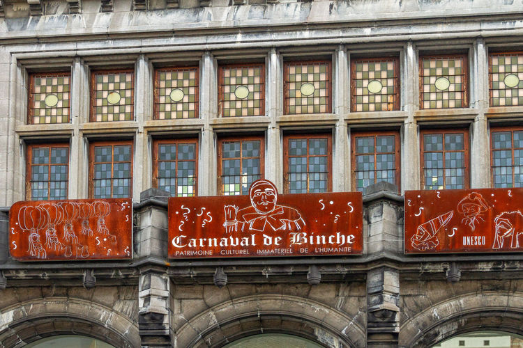 Architecture Building Exterior Built Structure Text Window No People Day Building City Red Western Script Communication Low Angle View Transportation Outdoors Sign Mode Of Transportation Travel Side By Side The Past Carnaval De Binche