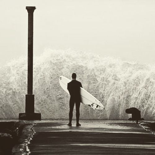 Man Surfing Ocean Greatness against water pierce