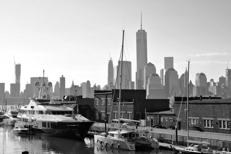 BOATS MOORED ALONG THE QUAYSIDE IN NEW YORK CITY