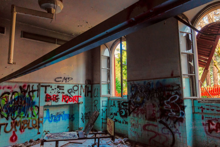 Mental Hospital  Graffiti Indoors  Architecture No People Window Built Structure Abandoned Wall - Building Feature Building Text Day Messy Creativity Empty Damaged Art And Craft Multi Colored Communication Ceiling