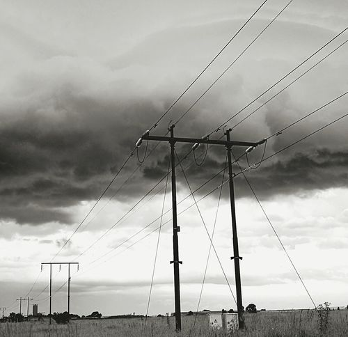 Electricity  Power Supply Electricity Pylon Power Line  Connection Cloud - Sky No People Technology Outdoors Low Angle View Storm Cloud Telephone Pole Telephone Line Cable Sky Clouds And Sky Black And White Collection  Telecommunications Equipment