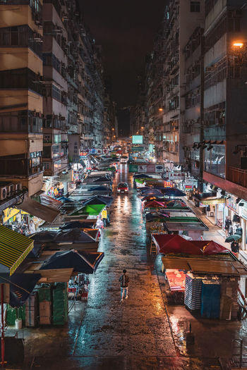 Fa Yuen Street Mongkok Rainy Night Market Stall Market Old Buildings One Person One Man Only EyeEm Best Shots EyeEm Selects EyeEm Gallery Building Exterior Architecture Built Structure City Night Illuminated Building Street Incidental People Transportation The Way Forward Mode Of Transportation High Angle View Residential District Motor Vehicle Real People Road Outdoors Street Market My Best Photo The Street Photographer - 2019 EyeEm Awards