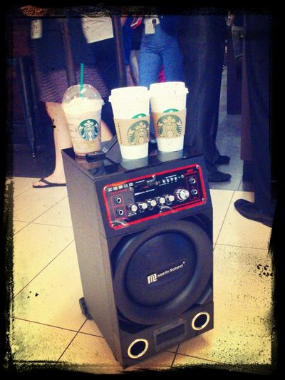 Starbucks in one hand, speakers in another! :D