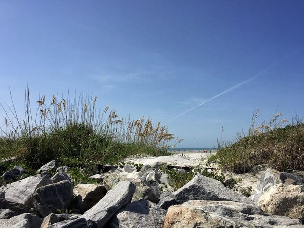 Rock lined inlet Jetty Park Port Canaveral Canaveral Florida Florida Beach Sea Grass